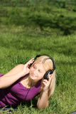 Girl listen to music Stock Images