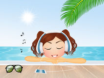 Girl listen to music in the pool Royalty Free Stock Images