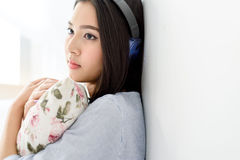 Girl listen using headphone and mobile phone. Royalty Free Stock Photo