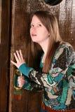 Girl listening at door Stock Image