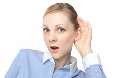 Girl listening intently Stock Photography