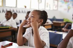Girl listening during a lesson at an elementary school Stock Image