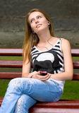 Girl is listening mp3 Stock Photography