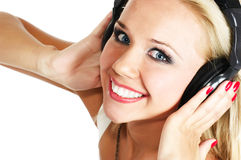 Girl listening music. Beautiful girl listening music on white background royalty free stock photos