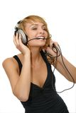 Girl listening music. Female listening to music on headphones Royalty Free Stock Images