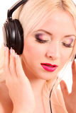 Girl listening music Royalty Free Stock Photos