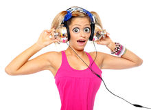 The girl listening a music. Funny picture of the girl with a headphones listening a music royalty free stock photo