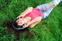 Girl listening music . Stock Photos