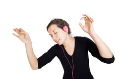 Girl listening a music. In headphones and dancing Royalty Free Stock Images