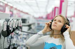 Girl listening music Stock Photography