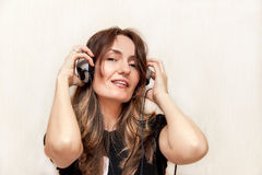 The girl is listening music. Royalty Free Stock Photo