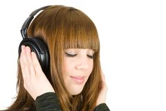 Girl listening music Stock Image