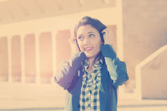 Girl listening music applied filter instagram style and a flare Royalty Free Stock Images