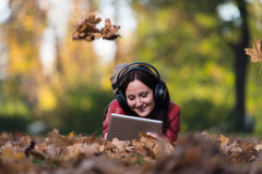 Girl Listening Music In The Autumn Sunshine Stock Photography