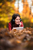 Girl Listening Music In The Autumn Sunshine Stock Photo