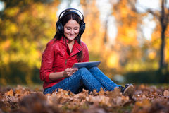 Girl Listening Music In The Autumn Sunshine Stock Image