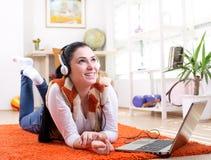 Girl listening music on the floor Stock Photo