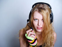 Girl listening music in headphones Royalty Free Stock Photography