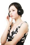 Girl listening music on headphones Stock Photo