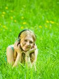 Girl listening music in headphones Stock Photos