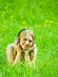 Girl listening music in headphones Stock Photos