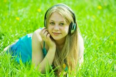 Girl listening music in headphones Stock Photography