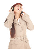 Girl listening music in headphones Royalty Free Stock Photos