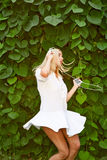 Girl listening music with headphones and dancing on nature background Stock Photos