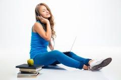Girl listening music in headphones on the floor Stock Image