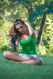 Girl listening music with headphones and holding a smartphone Stock Photos