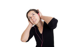 Girl listening a music in headphones Stock Photos