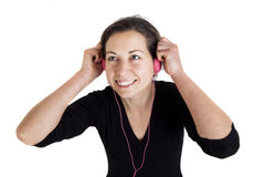Girl listening a music in headphones Royalty Free Stock Images