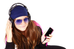 Girl listening music by headphones over white Stock Images