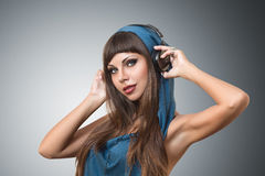 Girl listening music in headphones Royalty Free Stock Photo