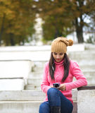 Girl listening music with her headphones in the street stock photos
