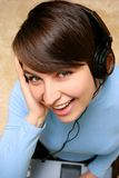 Girl listening music from laptop Stock Photography