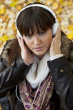 Girl listening music in the nature royalty free stock photo