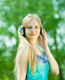 Girl listening music  outdoor Stock Images