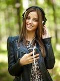 Girl listening music outdoor Stock Photo