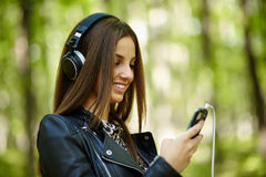 Girl listening music outdoor Stock Photography