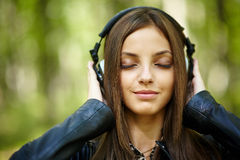 Girl listening music outdoor Royalty Free Stock Photos