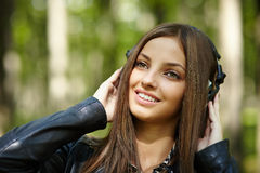 Girl listening music outdoor Royalty Free Stock Photo