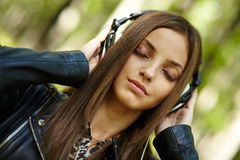 Girl listening music outdoor Royalty Free Stock Image