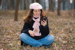 Girl listening music outdoors Stock Photo