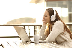 Girl listening music and relaxing Royalty Free Stock Photo
