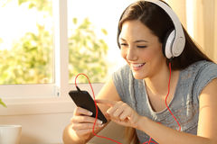 Girl listening music selecting song Stock Photo