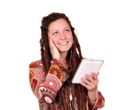 Girl listening music on tablet pc Royalty Free Stock Photos