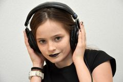 Girl listening music via headphones Royalty Free Stock Photography