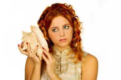 Girl listening shell Stock Photo