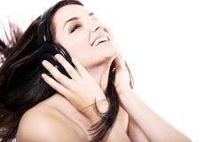 Girl listening to headphones Stock Photo